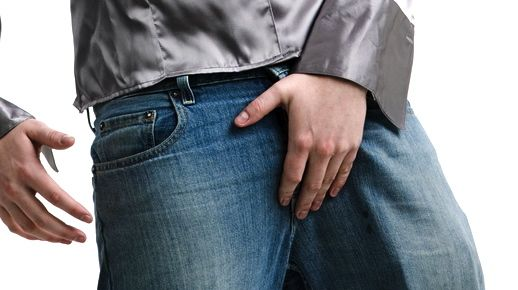 young-male-grabbing-crotch-via-Shutterstock.jpg